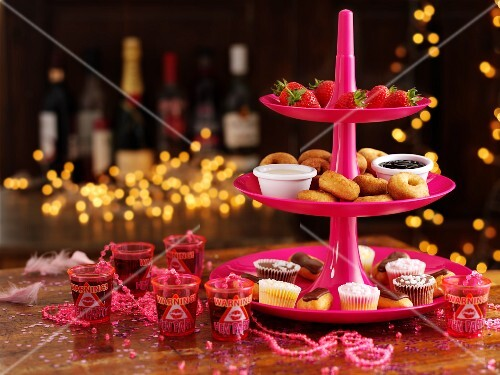 Cakes, biscuits and desserts for a party on a cake stand
