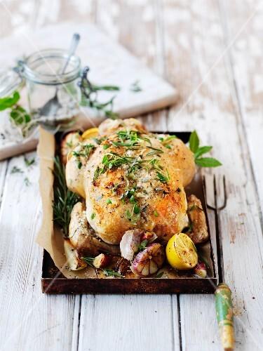 Roast chicken with herbs, garlic and lemon