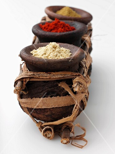 Moroccan spices in rustic wooden dishes