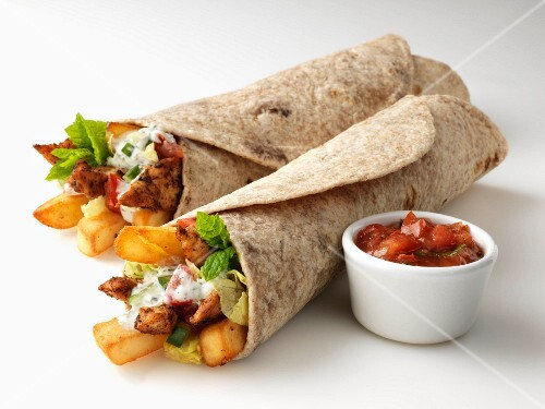 Chapatis filled with chicken and chips