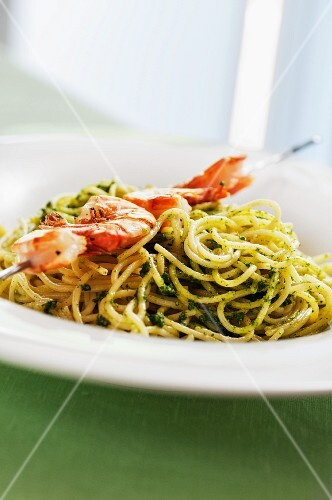 Spaghetti with stinging nettle pesto and a prawn skewer