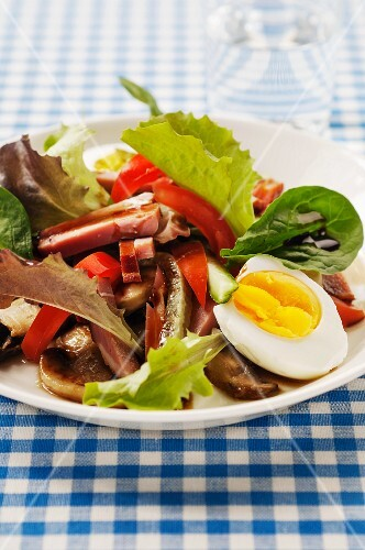 Salad with mushrooms, ham and egg