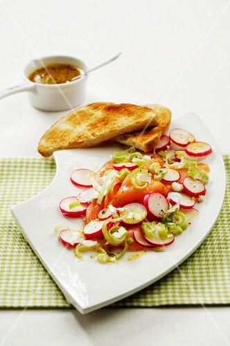 Marinated smoked salmon with radishes and spring onions