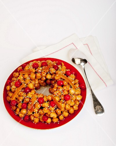 Strufoli (little balls of fried dough, Italy) with candied fruits