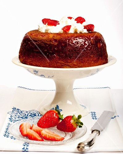 Babà with strawberries and cream