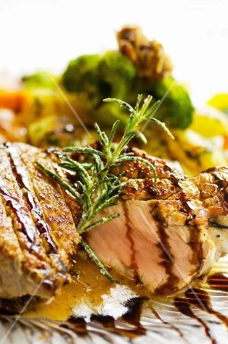 A pork chop with morel mushrooms and seasonal vegetables