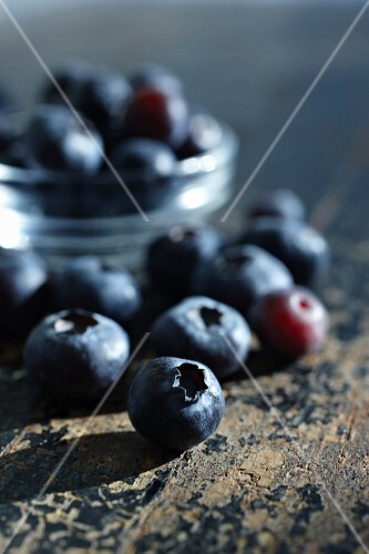 Blueberries on a rustic wooden surface