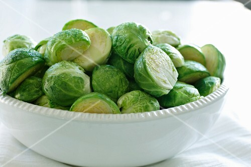 Steamed Brussels sprouts in a white bowl