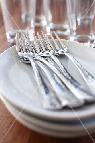 Forks on a stack of plates