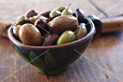 Mixed olives in a ceramic bowl