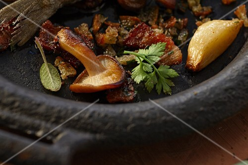 Fried shitake mushrooms with garlic, bacon and herbs