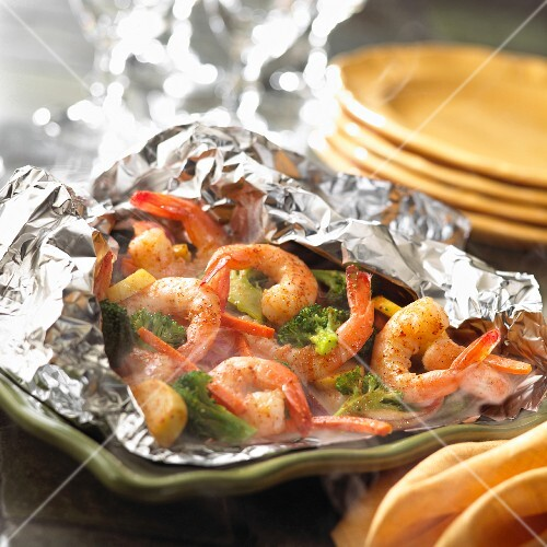Pranws and broccoli steamed in a foil pouch