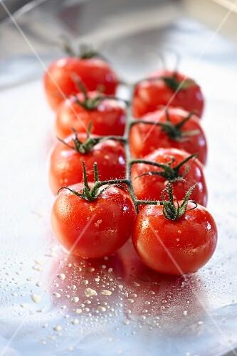 Vine tomatoes ready for roasting in aluminium foil
