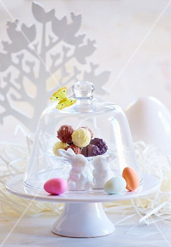 Truffle pralines under a glass cloches decorated for Easter