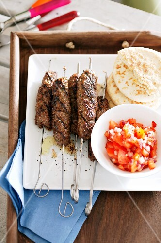 Kebabs with tomato salad and pita bread