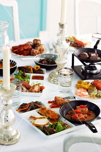A celebratory buffet with various dishes on platters and in pans