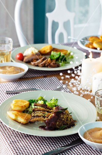 Lamb chops with salad with potato cakes