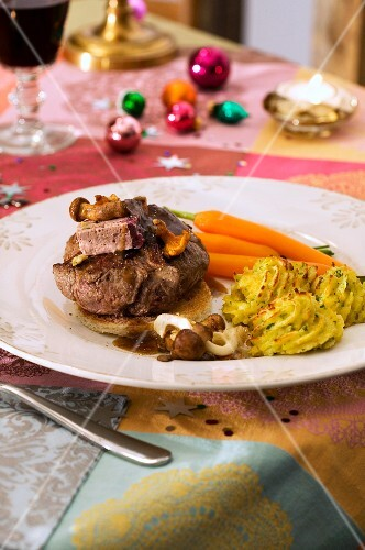 Roast beef with chanterelle mushrooms, carrots and duchess potatoes for Christmas dinner