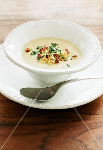 Cauliflower soup with croutons and herbs