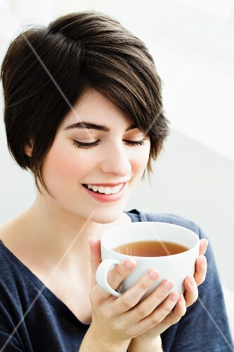A woman with a cup of tea
