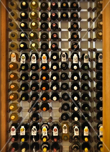 Lots of different bottles of wine in a wine rack