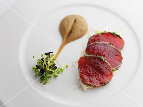 Slices of tuna with mustard and cress