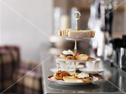 Sandwiches, cakes and pastries on a cake stand for afternoon tea