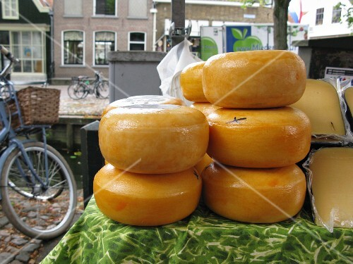 Wheels of Gouda cheese at a market