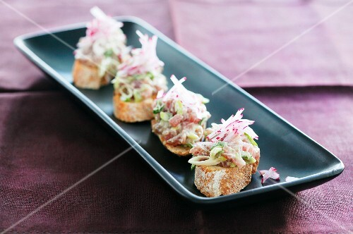 Slices of bread topped with tuna tartar