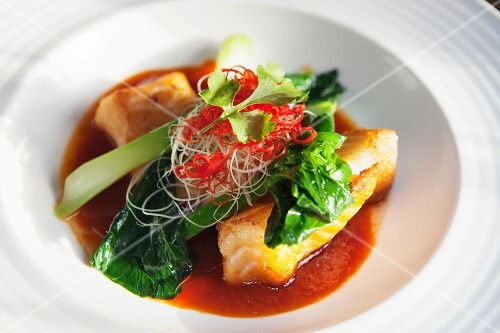 An oriental fish dish with chard