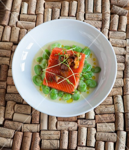 Salmon fillet with chanterelle mushrooms on broad beans