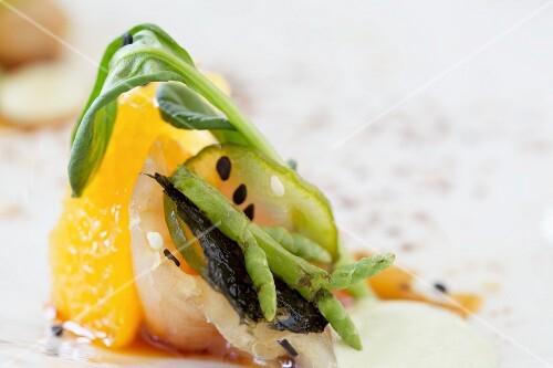 Fish carpaccio with orange fillet and basil