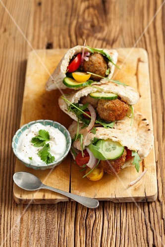 Pita breads filed with minced meat balls and cucumber