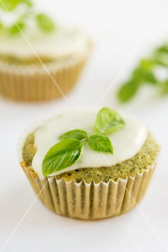 A basil cupcake with icing sugar