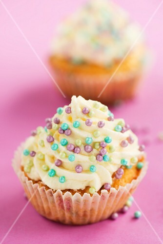 Cupcakes decorated with colourful sprinkles