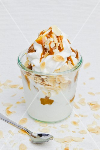 Frozen yogurt with slivered almonds and caramel sauce
