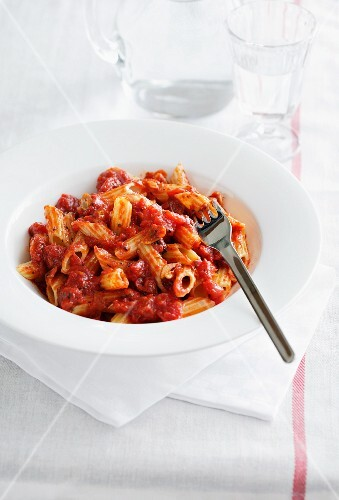 Penne all'arrabbiata (pasta with spicy sauce, Italy)