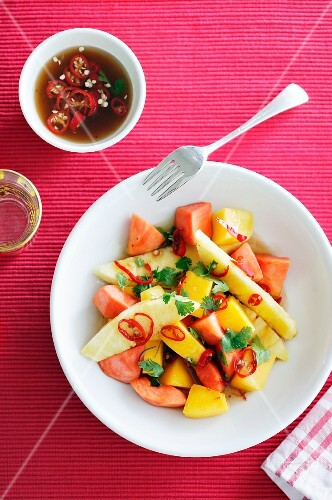 Exotic fruit salad with spicy chilli sauce