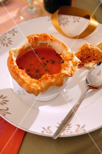 Festive tomato soup with a bread lid