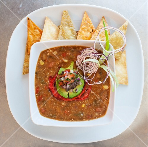 Chilli con carne with avocado and tortilla triangles