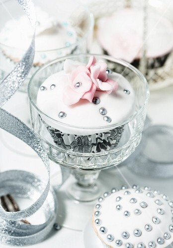 Festive cupcakes decorated with silver pearls and sugar flowers