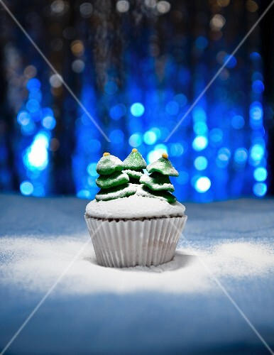 A Christmas cupcake decorated with Christmas trees