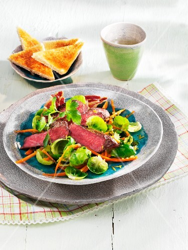 Warm Brussels sprouts salad with roast beef