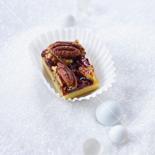 A pecan nut bar in a praline case