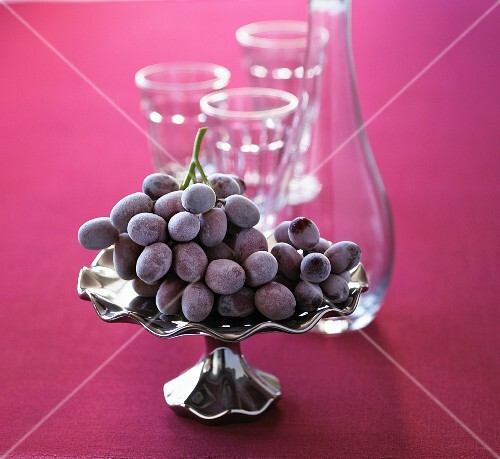 Iced grapes in a silver dish