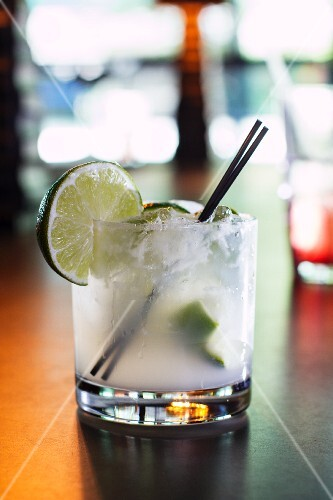 A lime drink with ice cubes