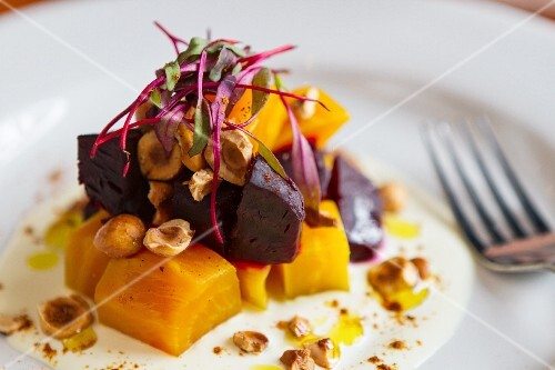 Beetroot and carrot salad with nuts (close-up)