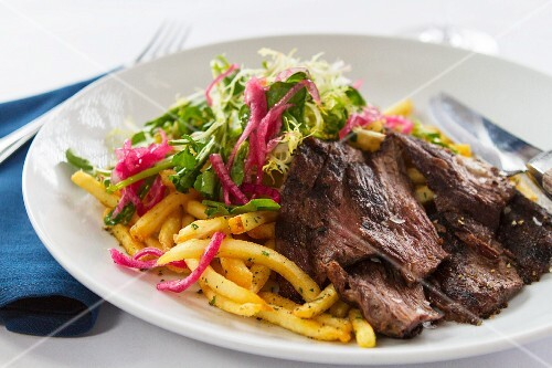 Beef with chips and a mixed leaf salad