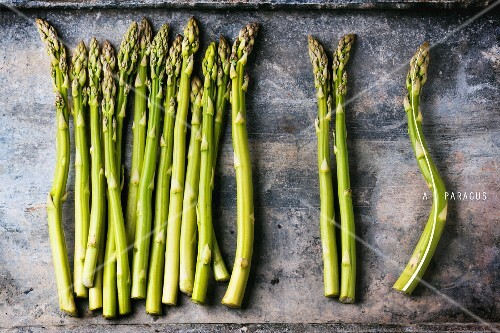 Green asparagus on a metal surface