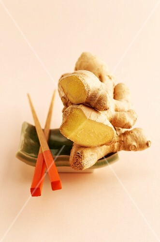 Fresh ginger on a dish with chopsticks